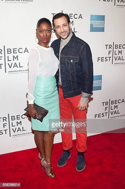 Logan Vaughn and Desmin Borges attend the Almost Christmas film premiere during the Tribeca Film Festival at BMCC in New York City �� LAN