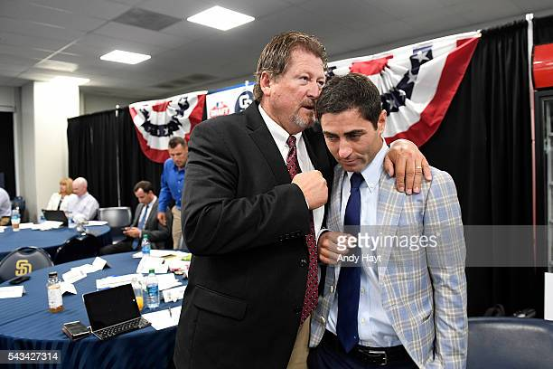 Logan White congratulates AJ Preller of the San Diego Padres after the selection of the team's first overall draft pick Cal Quantrill in the 2016 MLB...