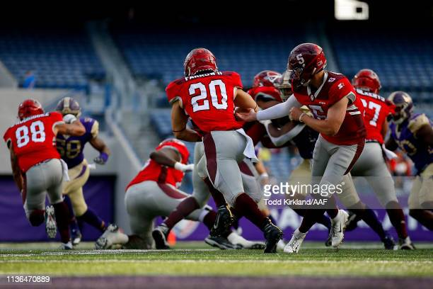 Logan Woodside hands the ball off to Kenneth Farrow, II of the San Antonio Commanders against the Atlanta Legends during the second half in the...