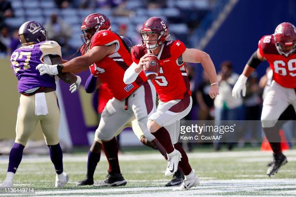 Logan Woodside of the San Antonio Commanders scrambles out of the pocket against the Atlanta Legends during the first half in the Alliance of...