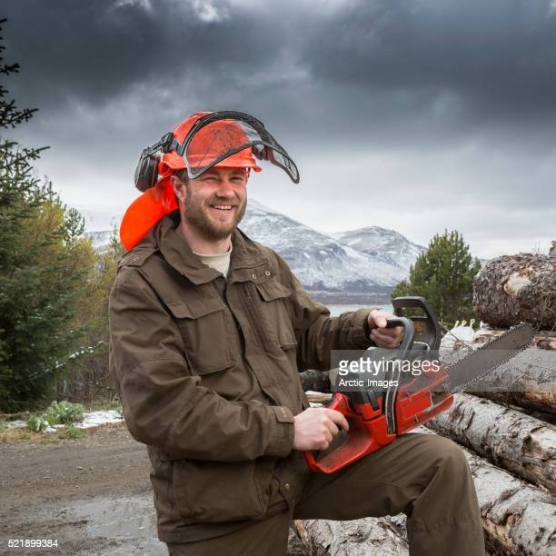 Logger with freshly cut trees, Western Iceland