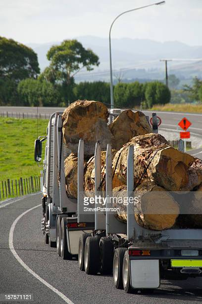 Logging Truck Driving down the Road