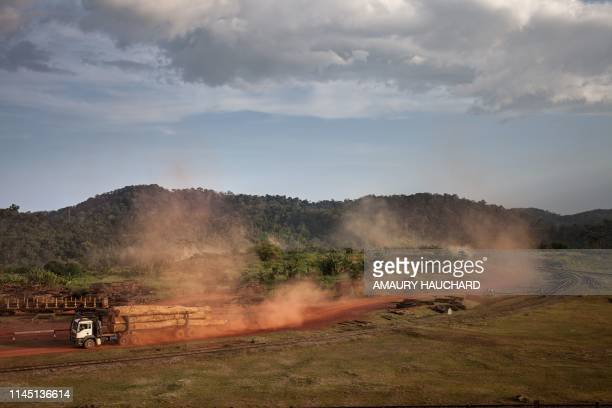 Logging trucks carrying Okoume wood leave the forest concession under sustainable management on April 24 2019 at the Ovindo national park near...