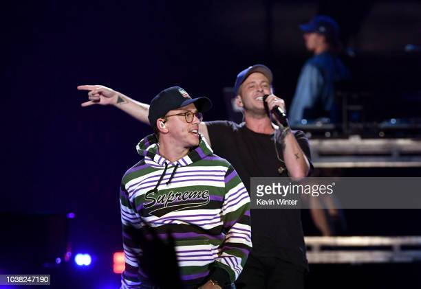 Logic and Ryan Tedder perform onstage during the 2018 iHeartRadio Music Festival at TMobile Arena on September 22 2018 in Las Vegas Nevada