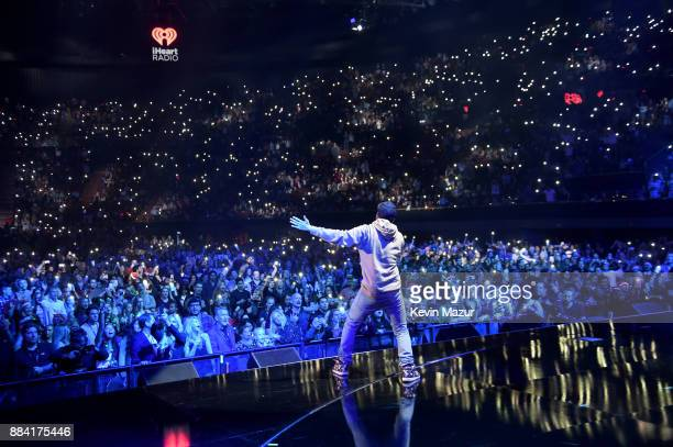Logic performs onstage during 1027 KIIS FM's Jingle Ball 2017 presented by Capital One at The Forum on December 1 2017 in Inglewood California