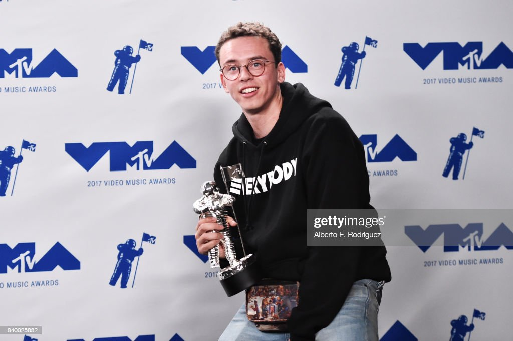 Logic poses with the Best Fight Against The System award for 'Black Spiderman' in the press room during the 2017 MTV Video Music Awards at The Forum on August 27, 2017 in Inglewood, California.