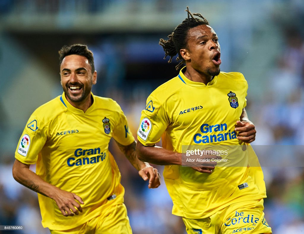 Logic Remy of Union Deportiva Las Palmas celebrates after scoring with during the La Liga match between Malaga and Las Palmas at Estadio La Rosaleda on September 11, 2017 in Malaga, .