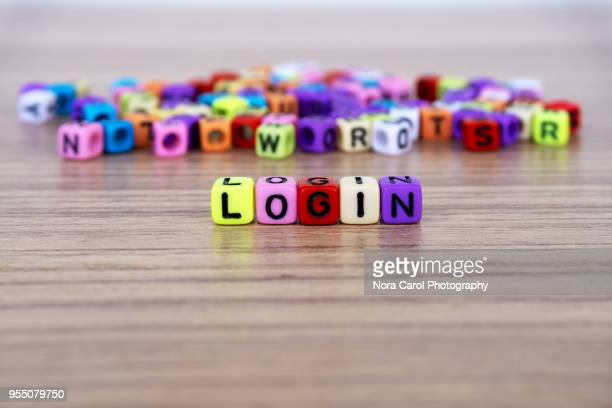 login word and alphabet letter beads - log on stock photos and pictures