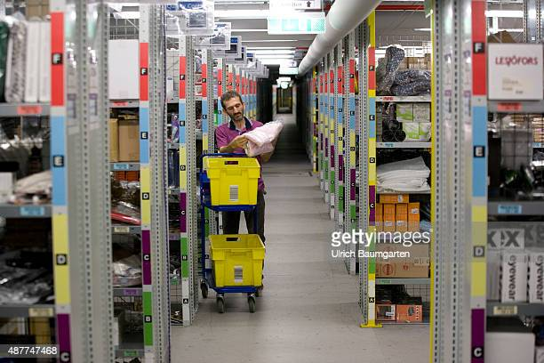 Logistic center of Amazon Germany GmbH in Koblenz Employee taking goods from a shelf
