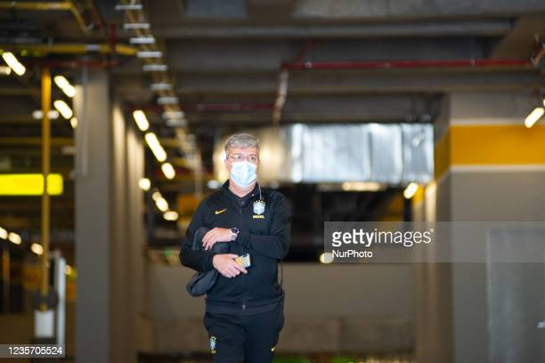 Logistic member of the security of Brazil's national football team is seen as members of the Brazil federation of football team board their bus at...