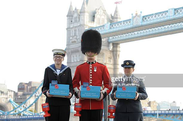 Logistician Zoe Braithwaite Guardsman Adam Deer and RAF Corporal Jenny Long attends a photocall launching Poppy Day at City Hall on November 2 2011...