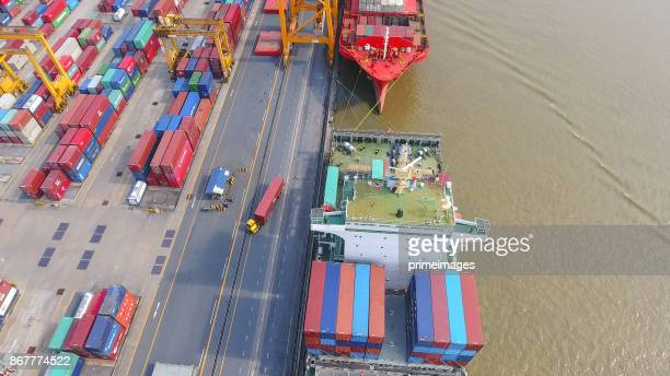logistics and transportation of container cargo ship and cargo working crane bridge in shipyard - science and technology stock pictures, royalty-free photos & images