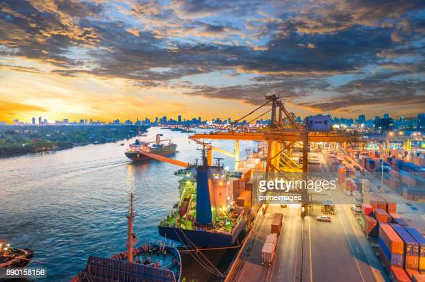 logistics and transportation of container cargo ship and cargo working crane bridge in shipyard - harbour stock pictures, royalty-free photos & images