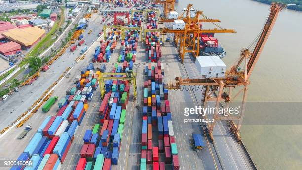 logistics and transportation of container cargo ship and cargo working crane bridge in shipyard - primeimages stock pictures, royalty-free photos & images