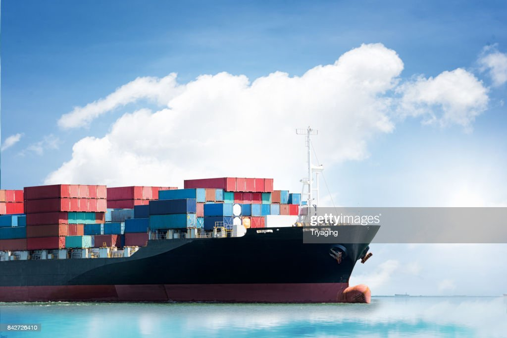 Logistics import export background of Container Cargo ship in seaport on blue sky, Freight Transportation : Stock Photo