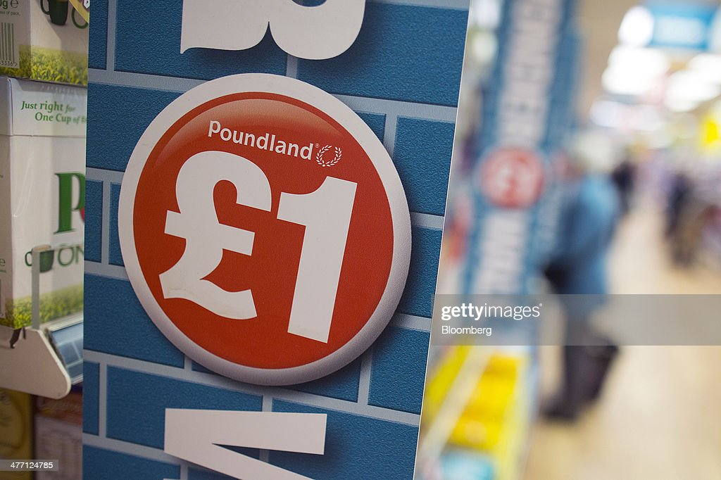 A logo advertising the cost of goods sits on a display shelf inside a Poundland discount store, operated by Poundland Group Plc in London, U.K., on Friday, March 7, 2014. Poundland Group Plc has demand for all the shares it is selling in an initial public offering that will value the U.K. discount retailer at as much as 750 million pounds ($1.3 billion), according to terms of the deal. Photographer: Simon Dawson/Bloomberg via Getty Images