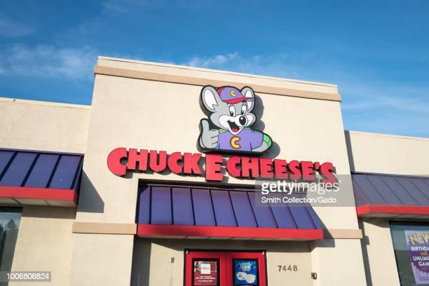 Logo and sign on facade of Chuck E Cheese's children's activity company in Dublin California July 23 2018
