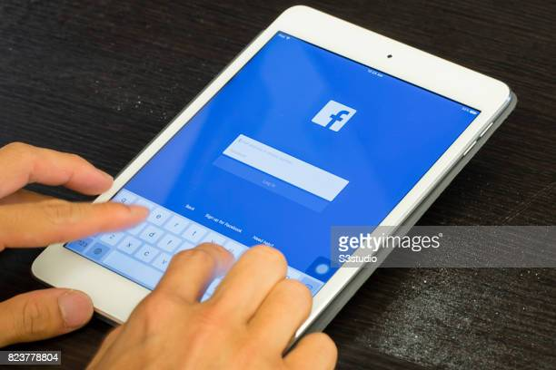 Logo and sign up page of Facebook the world's largest social networking site on a mobile device on 30 June 2017 in Hong Kong Hong Kong