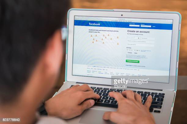 Logo and sign up page of Facebook the world's largest social networking site on a laptop screen on 27 July 2017 in Hong Kong Hong Kong