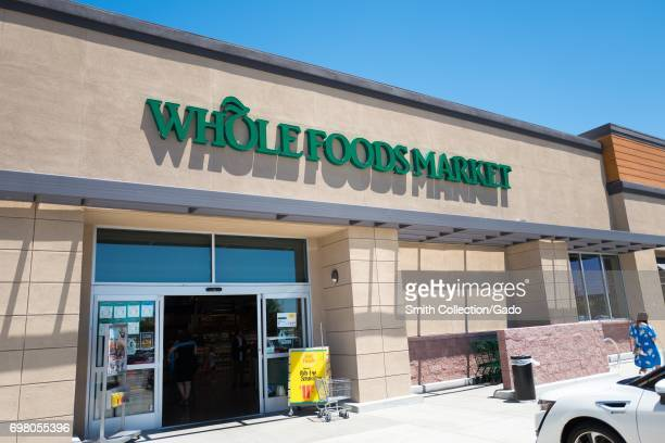 Logo and signage at the Whole Foods Market grocery store in Dublin California June 16 2017