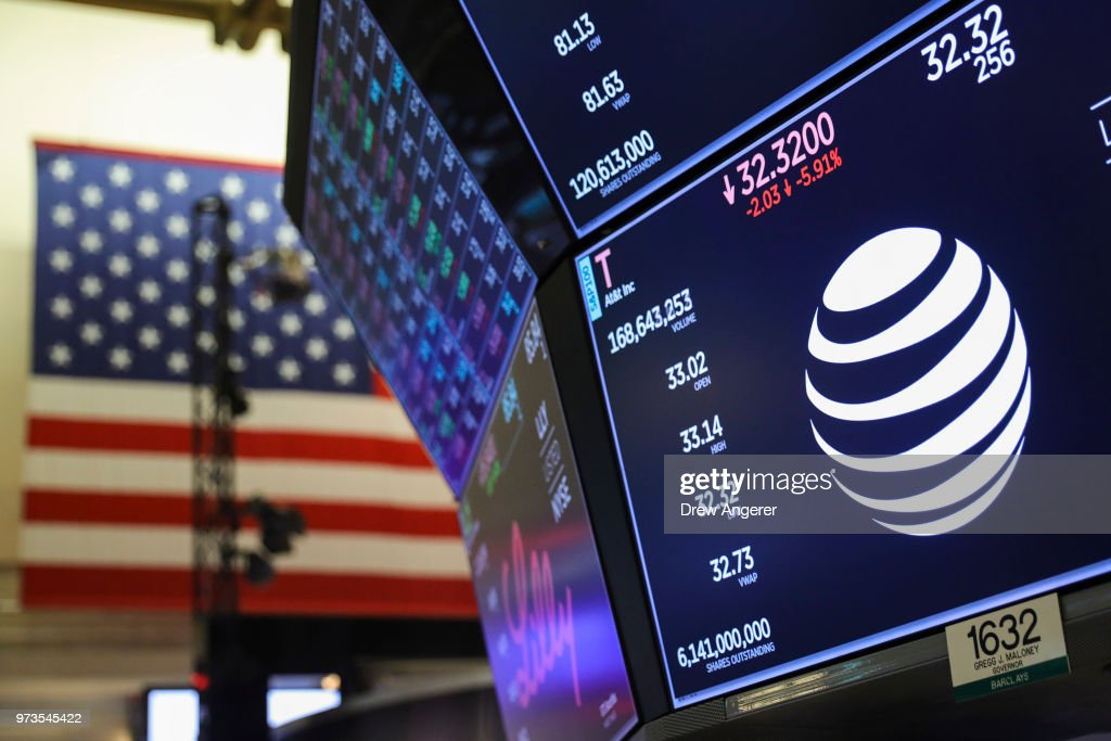 A logo and trading information for AT&T is displayed on a monitor on the floor of the New York Stock Exchange (NYSE) June 13, 2018 in New York City. Following news today that the Federal Reserve raised interest rates a quarter percentage point, the Dow Jones Industrial Average was down 119 points at the close.