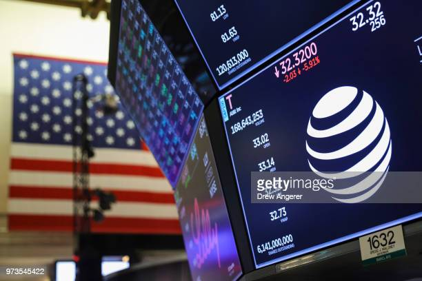 A logo and trading information for ATT is displayed on a monitor on the floor of the New York Stock Exchange June 13 2018 in New York City Following...