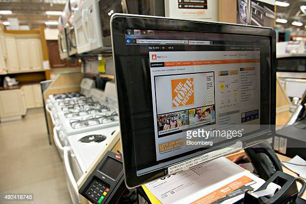 A logo appears on a computer monitor near a display of appliances at a Home Depot Inc store in Peoria Illinois US on Monday May 19 2014 Home Depot...