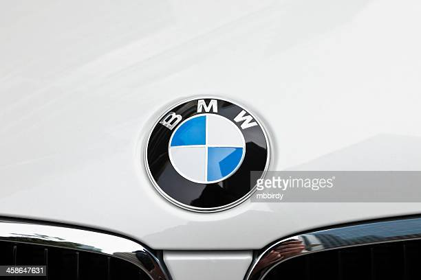 bmw logo badge on car - bmw stock pictures, royalty-free photos & images