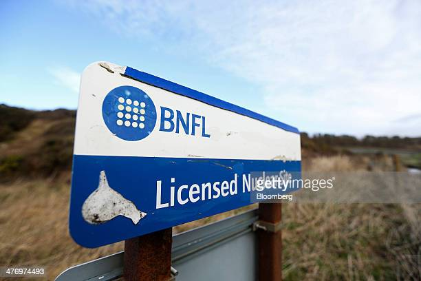 A BNFL logo belonging to former operator British Nuclear Fuels Plc sits on a sign near the perimeter fence of the Sellafield atomic fuel reprocessing...