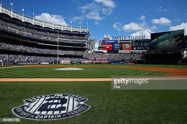 A logo commemorating the career of Derek Jeter of the New York Yankees is seen painted on the field during Derek Jeter Day on September 7 2014 before...