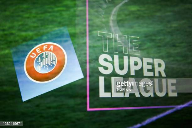 Logo displayed on a phone screen and The Super League logo displayed on a screen are seen in this multiple exposure illustration photo taken in...