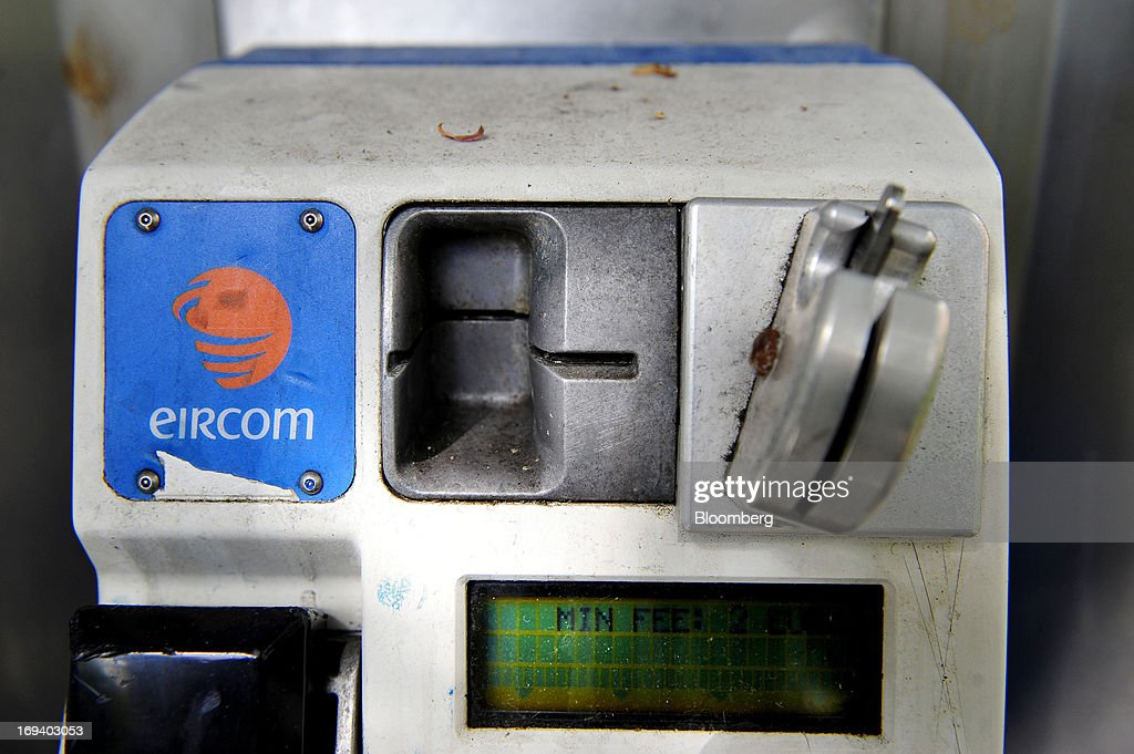 A logo for Eircom sits above a handset inside a fixed-line public telephone booth, operated by Eircom Group, in Dublin, Ireland, on Thursday, May 23, 2013. Eircom Group, which has changed ownership six times since 1999, 'would like to be consolidators rather than consolidated' amid expected mergers and acquisitions in the Irish telecoms market, its Chief Financial Officer Richard Moat said. Photographer: Aidan Crawley/Bloomberg via Getty Images