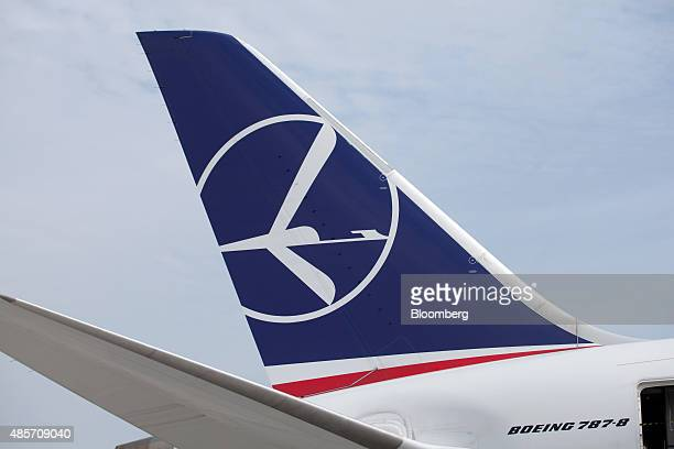 A logo for LOT Polish Airlines SA sits on the vertical stabilizer of a Boeing 7878 Dreamliner aircraft at Warsaw Chopin airport in Warsaw Poland on...