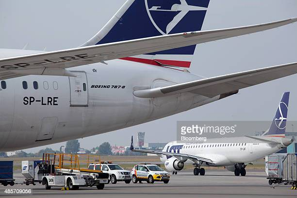 A logo for LOT Polish Airlines SA sits on the vertical stabilizer of a Boeing 7878 Dreamliner aircraft on the tarmac at Warsaw Chopin airport in...