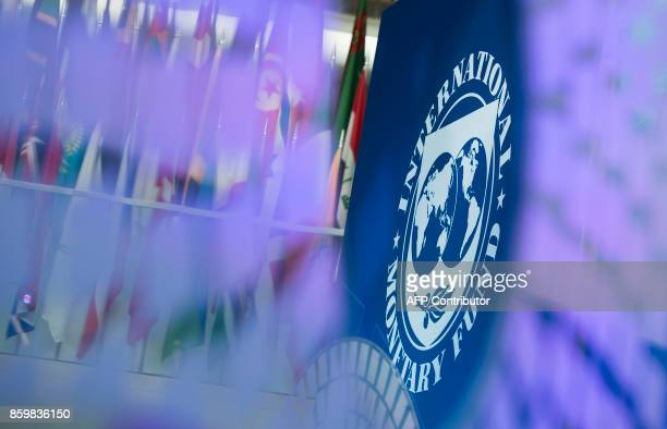A logo for the 2017 Annual Meetings is seen inside the International Monetary Fund headquarters in Washington DC during the 2017 IMF Annual Meetings...