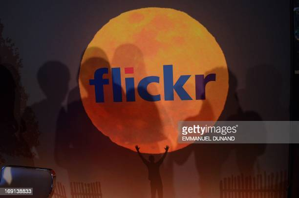 A logo for the Flickr website is displayed during an announcement that Yahoo acquired the Tumblr blogging site in order to upgrade its Flickr site in...