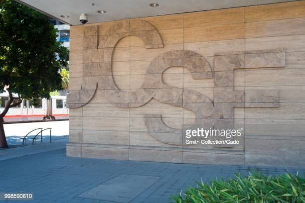Logo for the University of California San Francisco medical center embedded into the wall of a building in the Mission Bay neighborhood of San...