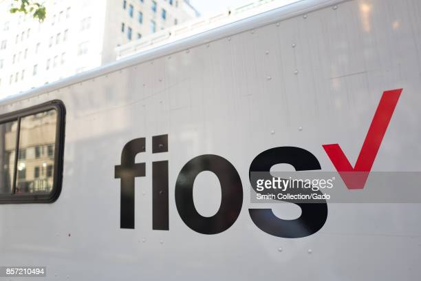 Logo for the Verizon Fios fiber optic internet service on the side of a truck on Madison Avenue on the Upper East Side of Manhattan New York City New...