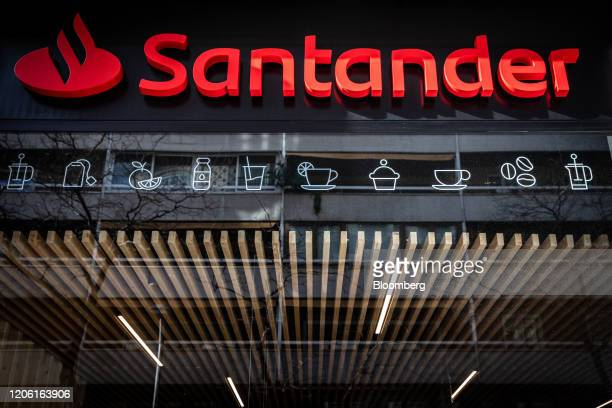 A logo hangs above the entrance to the Banco Santander SA Work Cafe coworking space in Barcelona Spain on Friday March 6 2020 Spanish bank shares...