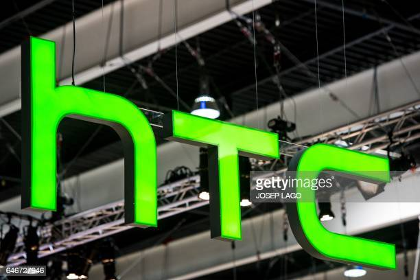 A HTC logo hangs from a beam during the Mobile World Congress on the third day of the MWC in Barcelona on March 1 2017 Phone makers will seek to...