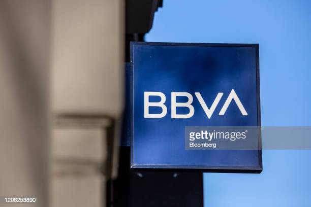 A logo hangs outside a Banco Bilbao Vizcaya Argentaria SA bank branch in Barcelona Spain on Saturday March 7 2020 Spanish bank shares soared after...