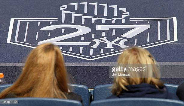 A logo honoring the New York Yankees 27 World Series titles is seen on the dugout during their game against the Los Angeles Angels of Anaheim on...