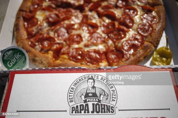 A logo in the likeness of John Schnatter founder and chief executive officer of Papa John's International Inc is displayed on the company's pizza box...