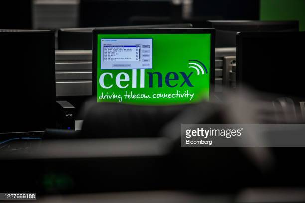A logo is dispalyed on a computer screen inside the Cellnex control room at the east control center of the Torre de Collserola telecommunications...