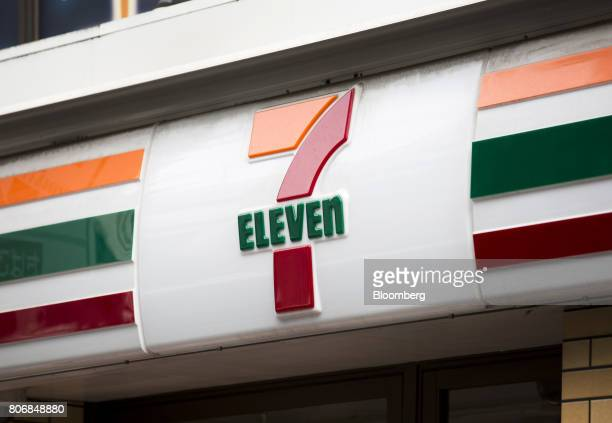 A logo is displayed at a 7Eleven convenience store operated by Seven i Holdings Co in Tokyo Japan on Monday July 3 2017 Seven i is scheduled to...