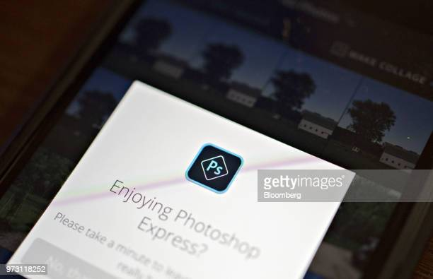 A logo is displayed in the Adobe Systems Inc Photoshop Express application on an Apple Inc iPhone in an arranged photograph taken in Tiskilwa...