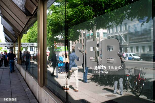 A logo is displayed in the window of an SEB AB bank branch also known as Skandinaviska Enskilda Banken AB in Gothenburg Sweden on Thursday May 23...