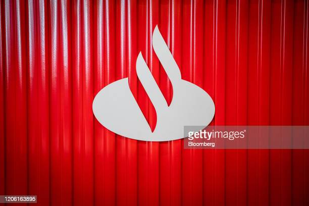 A logo is displayed inside the Banco Santander SA Work Cafe coworking space in Barcelona Spain on Friday March 6 2020 Spanish bank shares soared...
