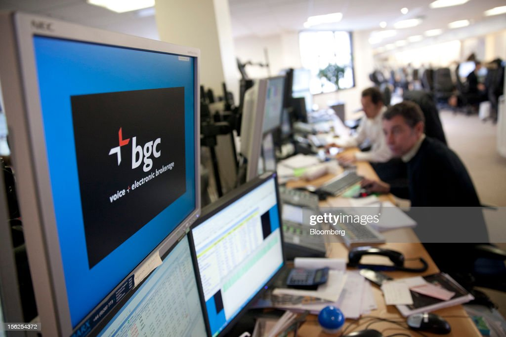 A logo is displayed on a computer screen at Aurel BGC's brokerage in Paris, France, on Monday, Nov. 12, 2012. European stocks fluctuated between gains and losses as finance ministers prepared to discuss Greek aid after the country's lawmakers approved the 2013 budget. Photographer: Balint Porneczi/Bloomberg via Getty Images