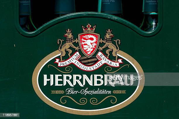 A logo is displayed on a crate of wheat beer at Herrnbraeu Gmbh Co KG's brewery in Ingolstadt Germany on Tuesday July 12 2011 Wheat futures surged...